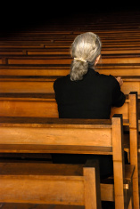 stock-photo-4036655-lonely-woman-praying-in-church